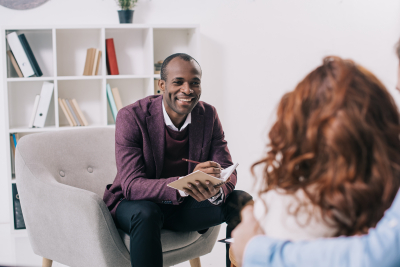 male staff smiling while counseling